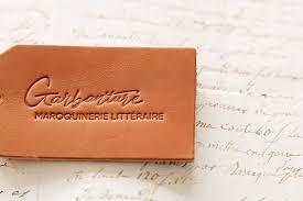 création logo Garbanture maroquinerie littéraire calligraphie